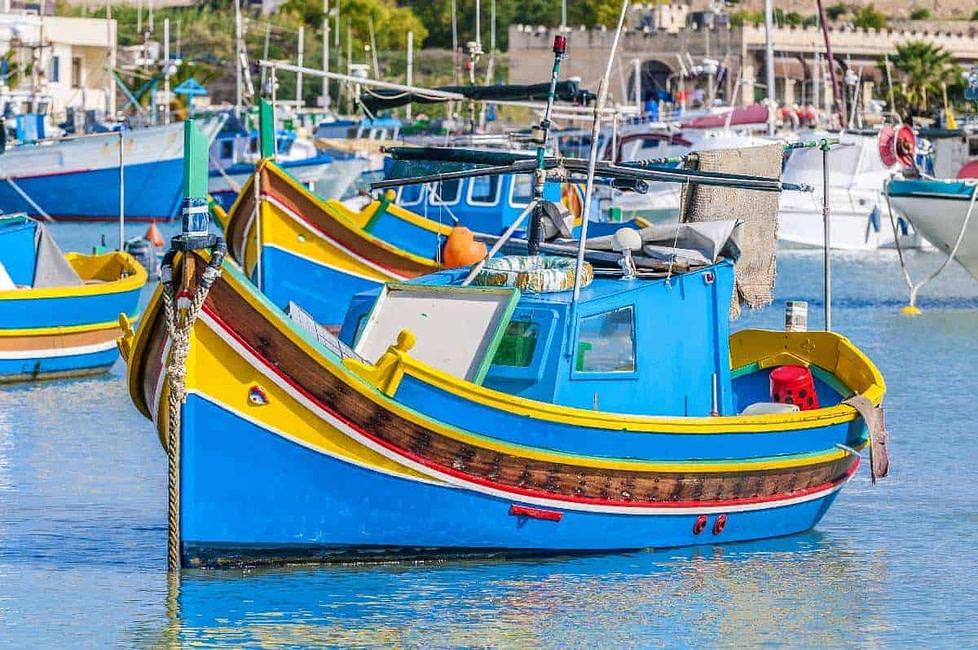 Maltese colourful fishing boats in a Marsaxlokk harbour, Malta.