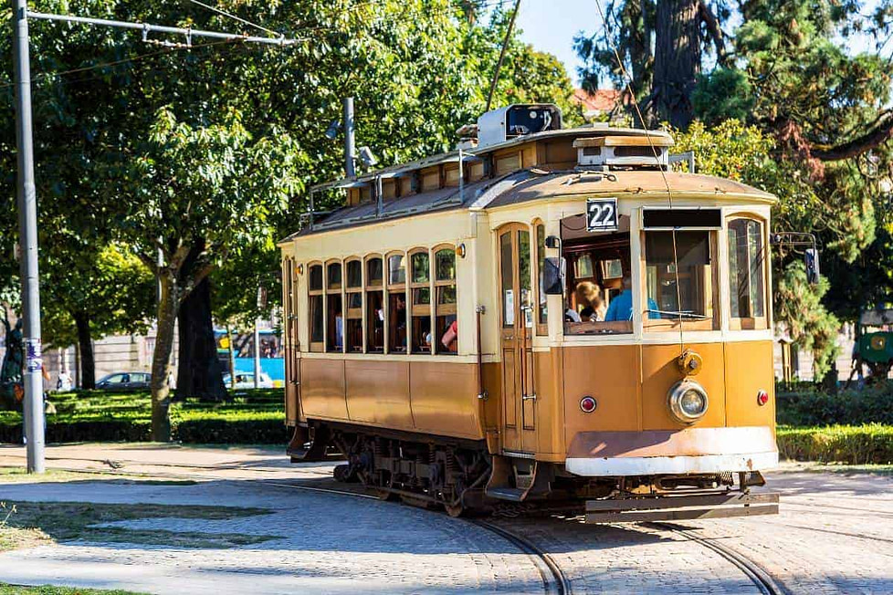 Porto's famous historic tram taking its passengers along the city's cobbled streets.