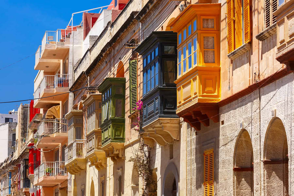 Living in Malta - traditional houses with colourful balconies