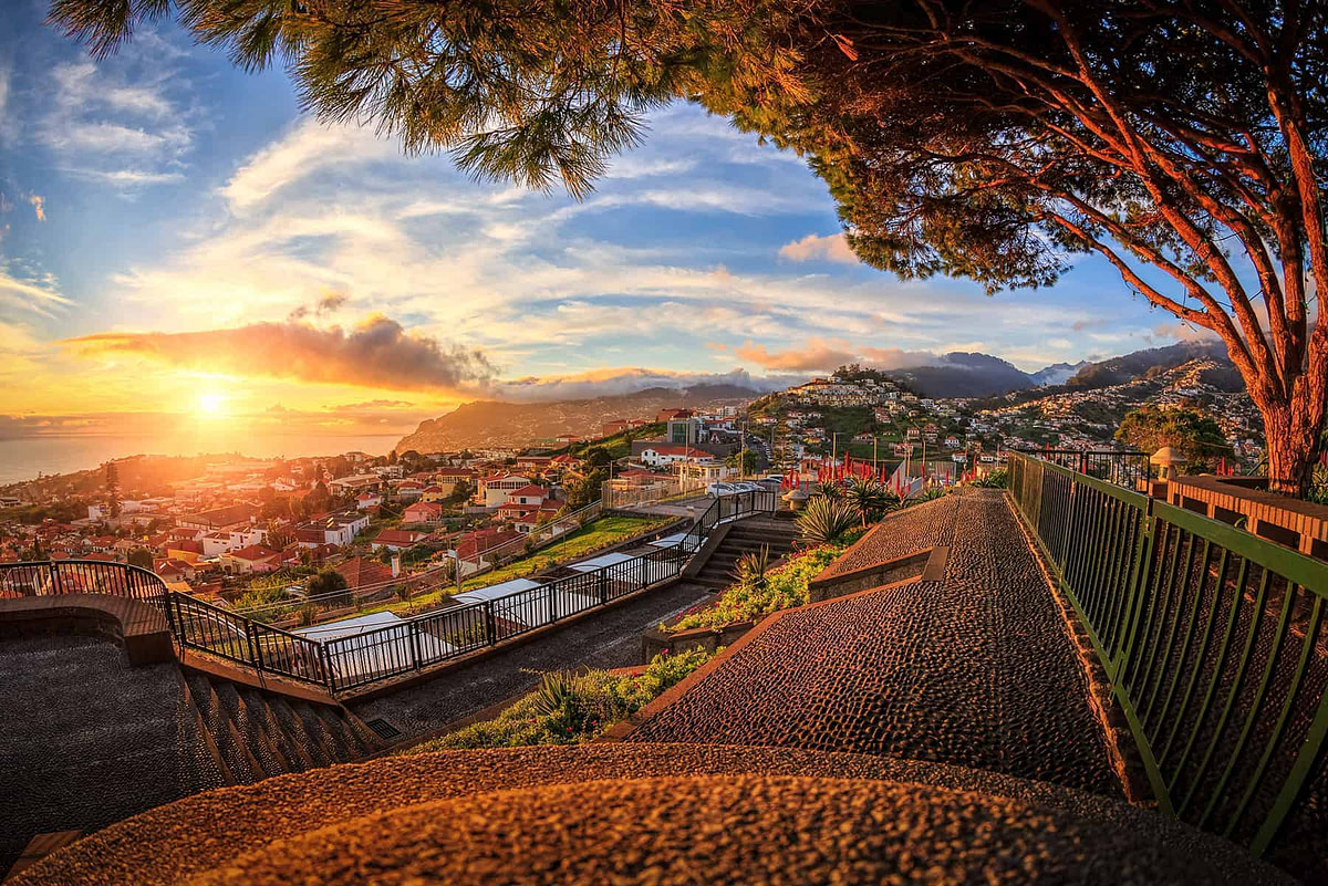 A beautiful sunset over a town on a mountain slope in Portugal