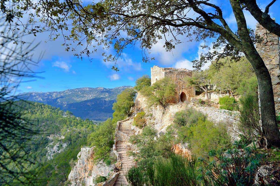 A mountain walk with derelict steps carved in stone leading to Alaro Castle in Mallorca, Spain