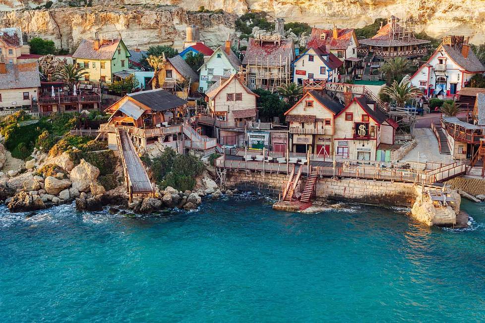 Popeye village, Il-Mellieha, Malta. This little village, also known as Sweethaven Village and Danish Village, is a film set purposely built village, now converted into a small attraction fun park.